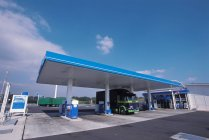 Gas station and truck under roof — Stock Photo