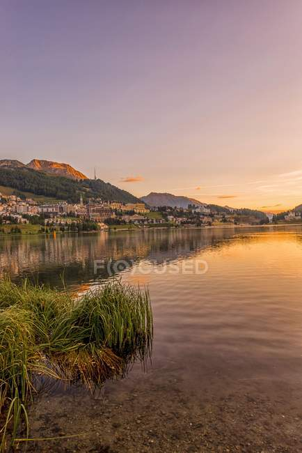 Lake with houses on shore at evening , St. Moritz, Switzerland, Grisons — Stock Photo