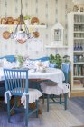 Interior with blue and white furniture and flowers on table — Stock Photo