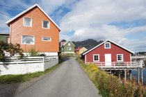 Colorful scandinavian village houses under cloudy sky — Stock Photo