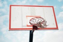 Low angle view of basketball hoop against blue sky — Stock Photo