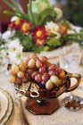 Grapes in glass dish on served table — Stock Photo