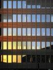 Sun lighted windows of office building — Stock Photo