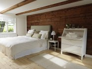 Scandinavian style bedroom with wood and white color theme — Stock Photo