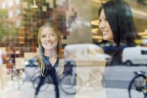 Two women smiling, selective focus — Stock Photo