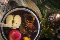 Elevated view of teaspoon in mulled wine — Stock Photo