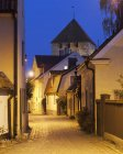 Illuminated old town street at dusk — Stock Photo