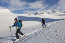 Men ski mountaineering, selective focus — Stock Photo