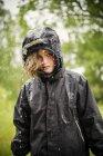 Blond girl in raincoat, selective focus — Stock Photo