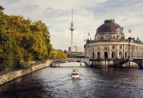 Boat moving on River Spree with communications tower in distant — Stock Photo