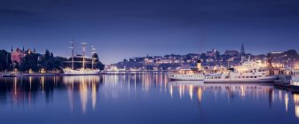 View of harbor and city buildings illuminated at night, Stockholm — Stock Photo