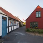 Small houses with danish flag and blue sky — Stock Photo