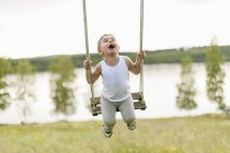 Boy playing on swing, selective focus — Stock Photo