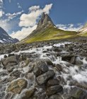 Rocky water stream at foot of mountains in Lapland — Stock Photo