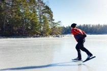 Man ice-skating on frozen lake, selective focus — Stock Photo