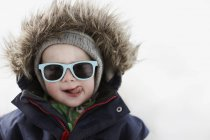 Portrait of boy sticking tongue out, selective focus — Stock Photo