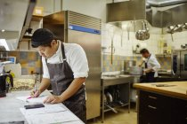 Chef working in commercial kitchen — Stock Photo