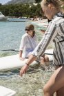 Two young girls and paddle boards, selective focus — Stock Photo
