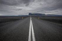 Asphalt road against storm clouds — Stock Photo