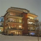 Facade of illuminated apartment building with christmas decorations in winter — Stock Photo