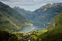 Ship at lake, town in mountains at Sunnmore — Stock Photo