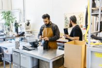 Two men making coffee at commercial kitchen, selective focus — Stock Photo