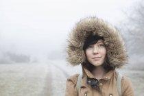 Portrait of teenage girl surrounded by mist in Blekinge, Sweden — Stock Photo