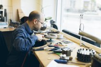 Goldsmith working with blowtorch at workshop, selective focus — Stock Photo