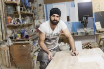 Carpenter sanding wood, selective focus — Stock Photo