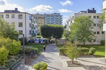 Park by apartment buildings in Stockholm, Sweden — Stock Photo