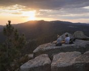 Men on rock at sunset in Sequoia National Park in California — Stock Photo