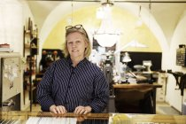 Portrait of goldsmith at counter of store — Stock Photo