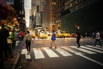 People crossing Manhattan street, selective focus — Stock Photo