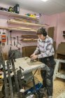 Carpenter sanding wood, selective focus — Stock Photo