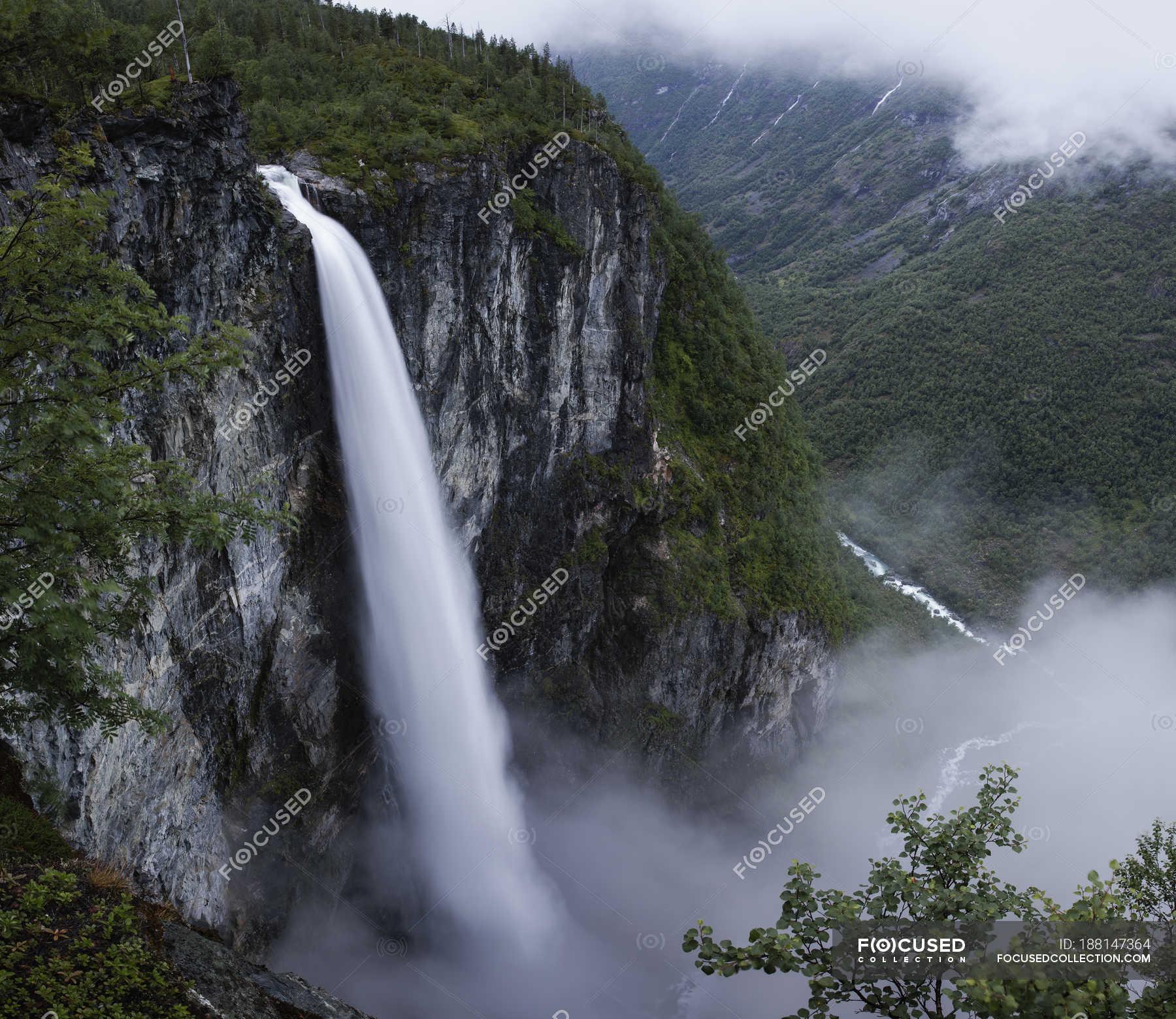 Jotunheimen Mountain Range And Utladalen Valley With Vettisfossen Waterfall Daylight Peaks Stock Photo 188147364