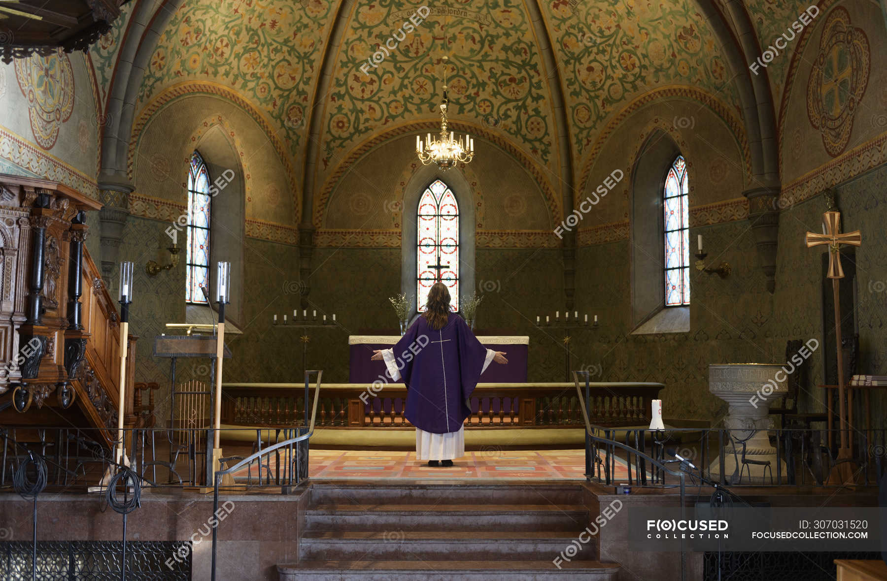 Priest In Purple Robes Standing At Chancel In Church Traditional Clothing Selective Focus Stock Photo 307031520