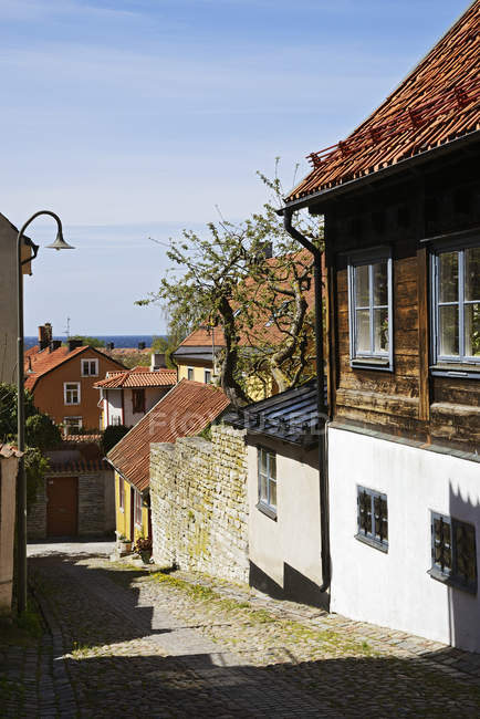 Old town houses in bright sunlight — Stock Photo