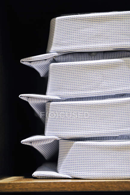 Stack of clean male shirts, side view — Stock Photo
