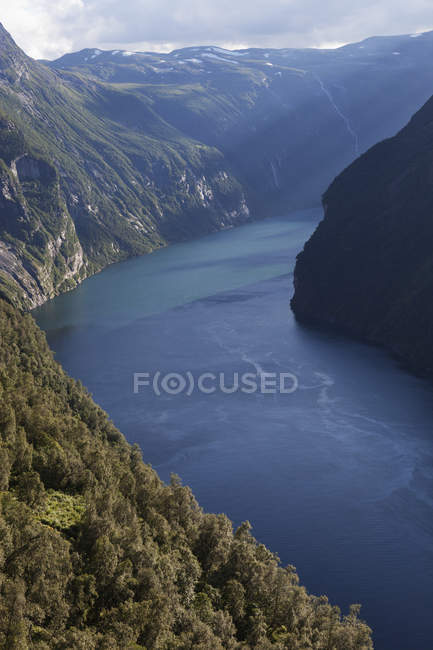 Fjord water and green hills in sunlight — Stock Photo
