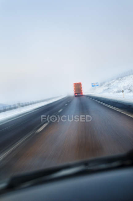 Highway with truck seen from moving car — Stock Photo