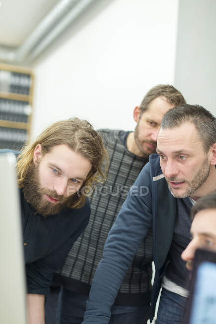 Focused male architects working in office — Stock Photo