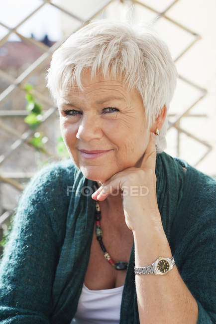 Portrait of mature woman with grey hair — Stock Photo