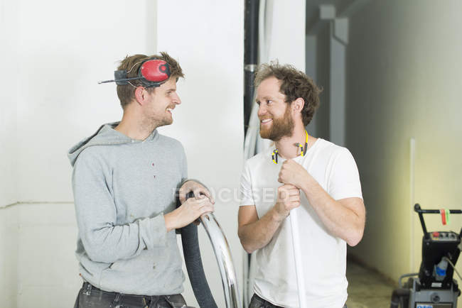 Two men renovating house, selective focus — Stock Photo