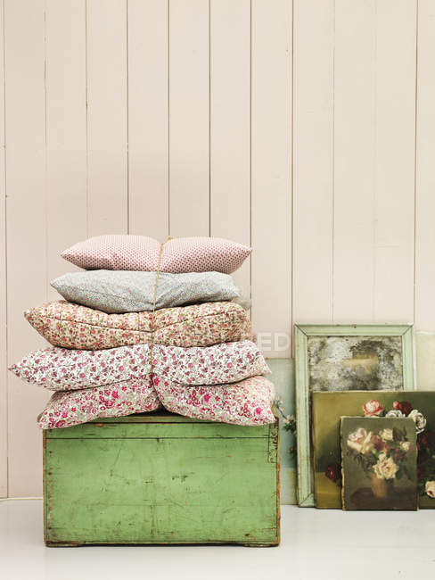 Pillows, dresser and paintings in country home — Stock Photo
