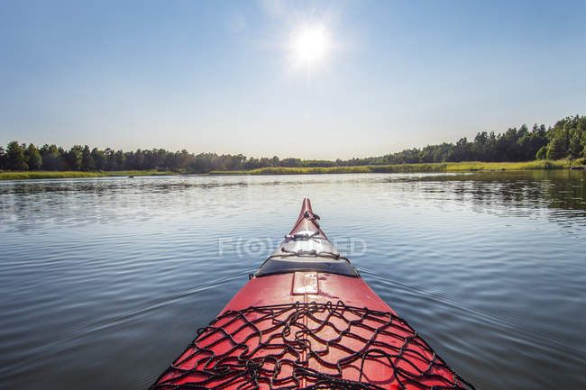 View of lake with sun lighted landscape from Kayak — Stock Photo