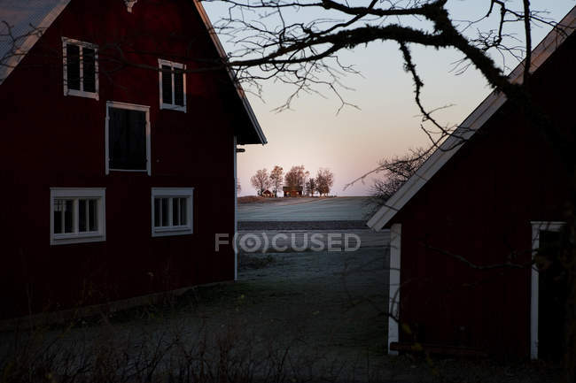 Residential houses and frosted field at dusk — Stock Photo