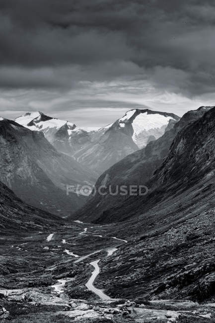 View of mountains and valley with winding road — Stock Photo