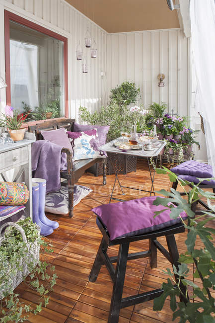 Cozy terrace with table and purple decor — Stock Photo