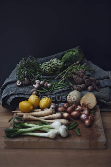 Variety of vegetables, mushrooms and lemons, still life — Stock Photo