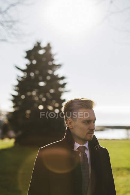 Portrait of businessman in park, focus on foreground — Stock Photo